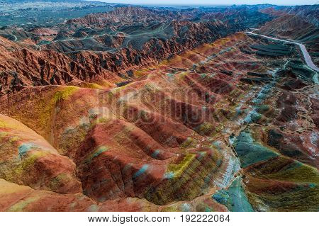 Aerial drone view of the colorful rainbow mountains with amazing pattern in Zhangye danxia landform geological park in Gansu province, China, May 2017