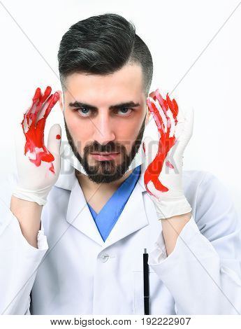 Doctor With Mad Face Expression Holds His Bloody Hands Up