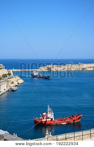 VALLETTA, MALTA - MARCH 30, 2017 - Elevated view of the grand harbour with fort to the rear and ships in the foreground Valletta Malta Europe, March 30, 2017.