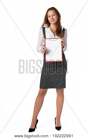 The beautiful young woman shows a blank clipboard on white a background
