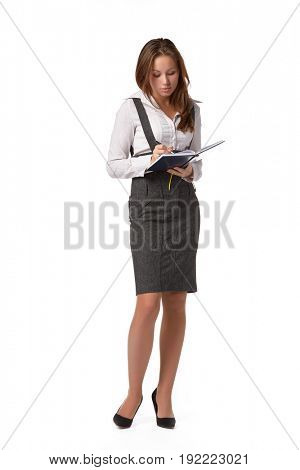 The beautiful girl stand with coloured writing-books on a white background. The student.
