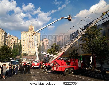 KIEV - UKRAINE - JUNE 2017:  Fire in historic building at Kreschatik Street at city center. Fireman, poliece, Firefighters extinguish a fire near famous TZUM department store. 20-th of June