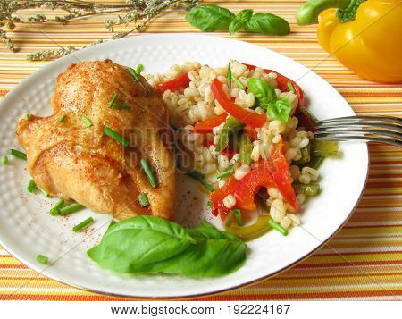 hicken with pearl barley and bell pepper vegetables