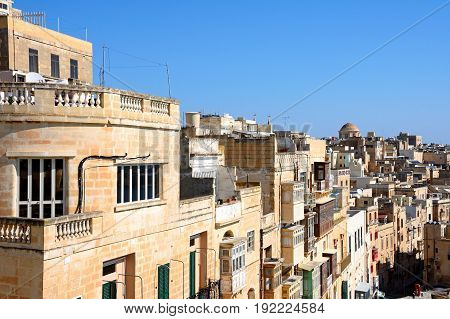 VALLETTA, MALTA - MARCH 30, 2017 - View of the East side waterfront buildings seen from Upper Barrakka gardens Valletta Malta Europe, March 30, 2017.