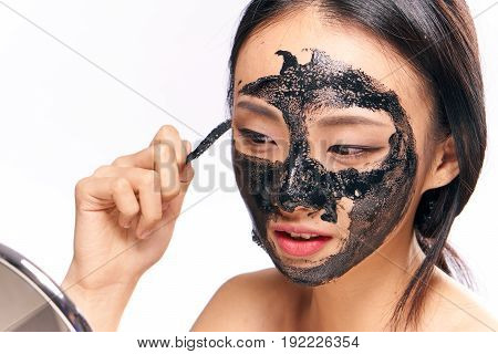 Beauty, health, black mask for face, girl on isolated background, woman on white background.