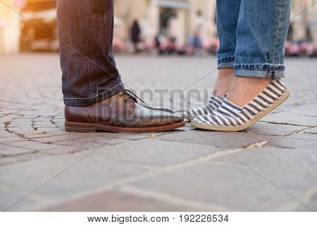 Legs and shoes of a couple in love