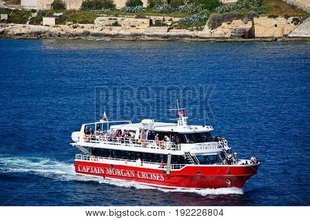 VALLETTA, MALTA - MARCH 30, 2017 - Passengers aboard a tour boat in the harbour Valletta Malta Europe, March 30, 2017.