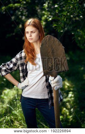 Summer cottage, summer season, garden, gardening, gardener, girl holding a shovel, shovel.