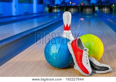 bowling shoes and ball for bowling game on the background of the playing field