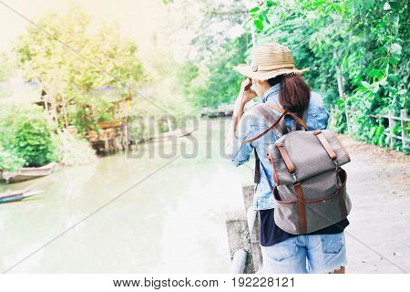 Young asian woman traveling against beautiful tropical scenery Happy traveler Lifestyle concept