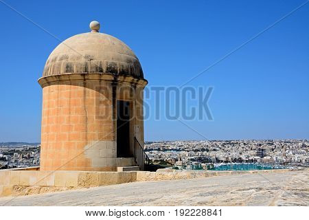 View of St Michaels Bastion with Manoel Island and Sliema to the rear Valletta Malta Europe.