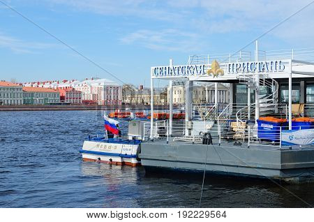 SAINT PETERSBURG RUSSIA - MAY 1 2017: Unknown people are on sightseeing boat at Senate Pier on Neva River St. Petersburg Russia