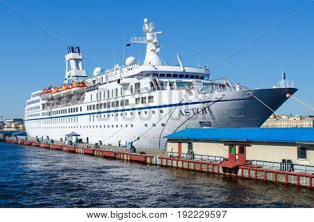 SAINT PETERSBURG RUSSIA - MAY 2 2017: Sea cruise ship Astor on quay on Neva at English embankment in St. Petersburg Russia