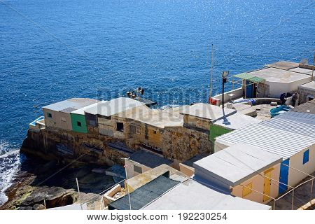 VALLETTA, MALTA - MARCH 30, 2017 - Fishermens cabins along Triq Il-Mediterran by the shoreline Valletta Malta Europe, March 30, 2017.