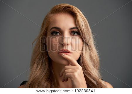 Close-up portrait of beautiful sexy fashion model with blond hair and evening makeup