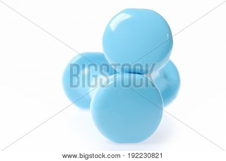 Two round edges of cyan blue dumbbells making minimalistic art composition isolated on white background. Defocused close up