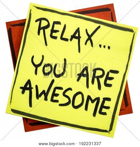 Relax, you are awesome - reminder or positive affirmation - handwriting on an isolated sticky note