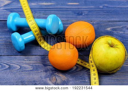 Gym And Health Concept, Dumbbells Weight With Measuring Tape, Fruit