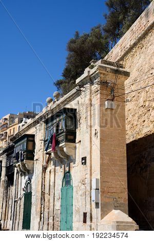 VALLETTA, MALTA - MARCH 30, 2017 - Traditional waterfront buildings with wooden balconies Valletta Malta Europe, March 30, 2017.