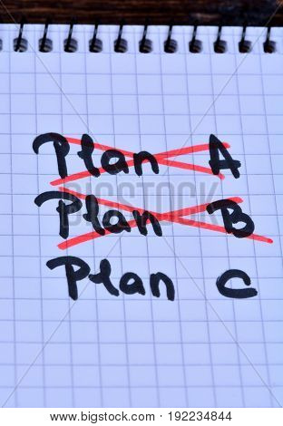 Plan A Plan B and Plan C on notebook close-up