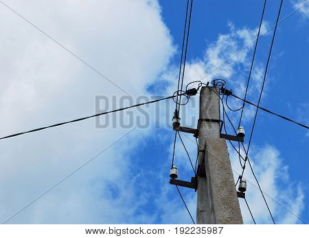 Electric distributor against a blue sky with white clouds