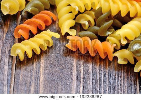 Colorful pasta on wooden table close up