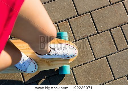 Girl With Wooden Longboard Skateboard.