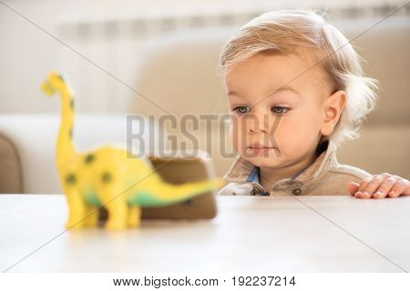 Portrait Of Little Boy With Blue Eyes Watching Cartoons On The Cell Phone.