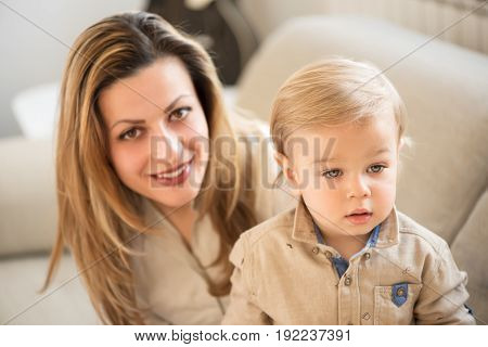 Portrait Of Beautiful Mother And Little Son In Front. Family Values.
