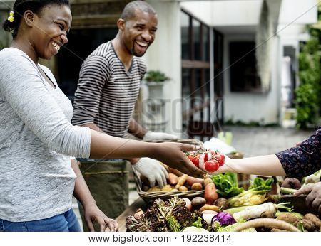 African descent people with various fresh organic vegetable