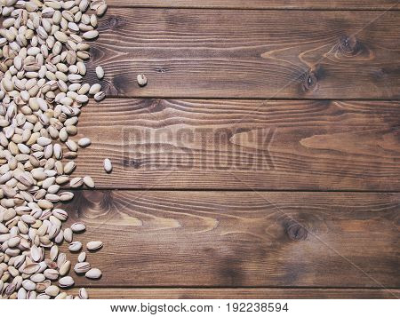 Salty Pistachios On Wooden Background. Food