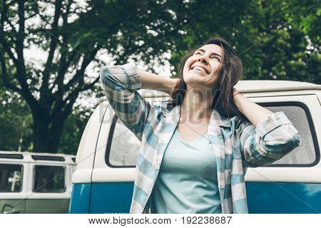 woman injoy her trip on van even in rainy weather