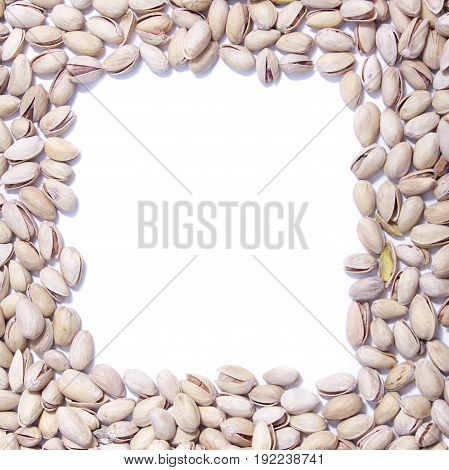 Food Frame Of Salty Pistachios On White Background.