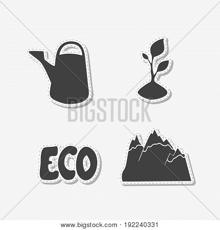 Set of hand drawn stickers with watering can, sprout, mountains and eco sign. Templates for design or brand identity. Vector illustration