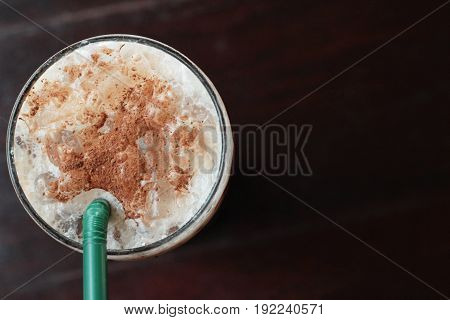 Iced chocolate with milk on wood background