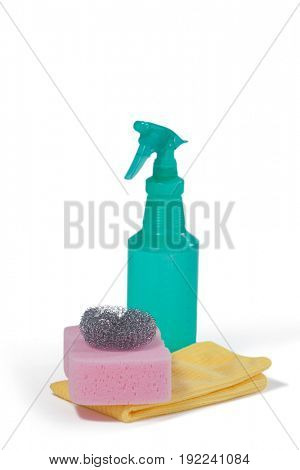 Detergent spray bottle, scrubber, sponge pad and napkin cloth arranged on white background