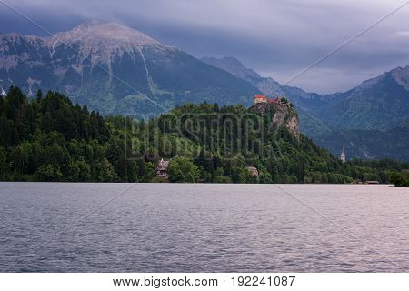 Amazing view on Bled lake, Bled castle at sunrise with mountain Triglav in background. Slovenia, Europe