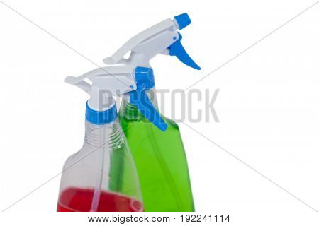 Close-up of detergent spray bottles on white background