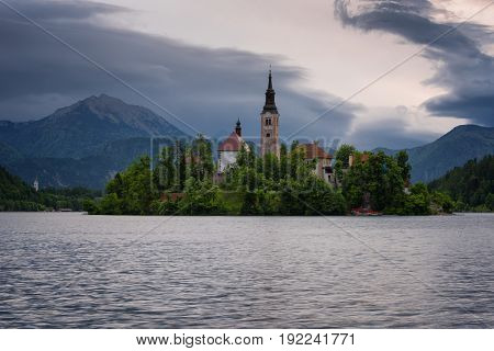 Amazing spring sunrise on Bled lake, Island, Church And Castle with Mountain Range (Stol, Vrtaca, Begunjscica) In The Background - Bled, Slovenia, Europe