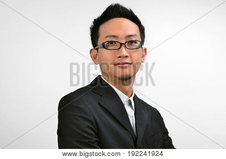 Portrait of Southeast Asian businessman standing isolated on white background.