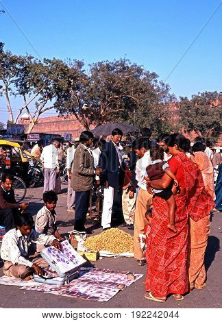 DELHI, INDIA - NOVEMBER 20, 1993 - Roadside stalls and sellers with locals looking on outside the Red Fort Delhi Delhi Union Territory India, November 20, 1993.