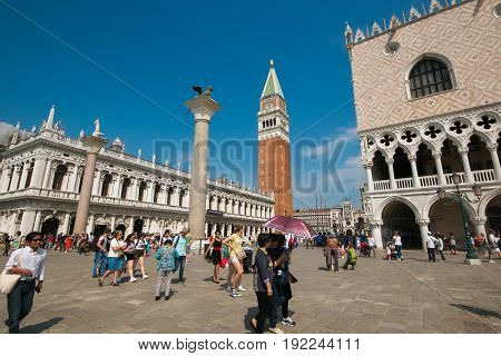 VENICE, ITALY - MAY 23, 2017: Tourist in Saint Mark square under the sun