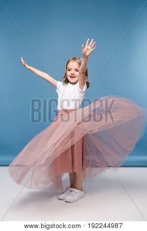 Adorable Little Girl In Pink Skirt Posing In Studio