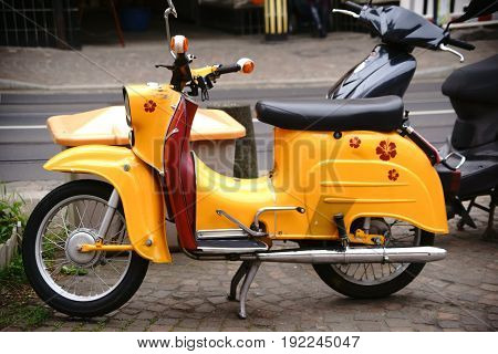 MAINZ, GERMANY - APRIL 20: The side view of an old nostalgic motor cycle a moped brand swallow on April 20, 2017 in Mainz.