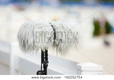 The professional microphone against the background of arena
