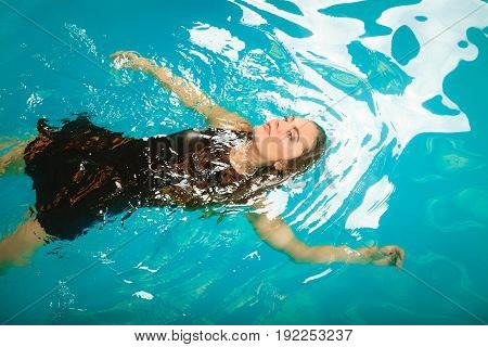 Woman Dreaming Relaxing In Swimming Pool Water.