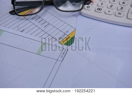 closeup accounts number on a printed paper ,Calculator and glasses. finance business sheet .
