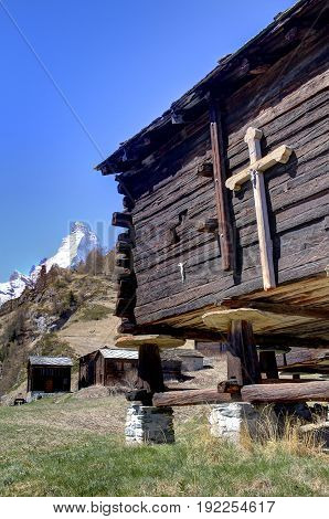A crucifix on an old chalet in the Swiss Alps.