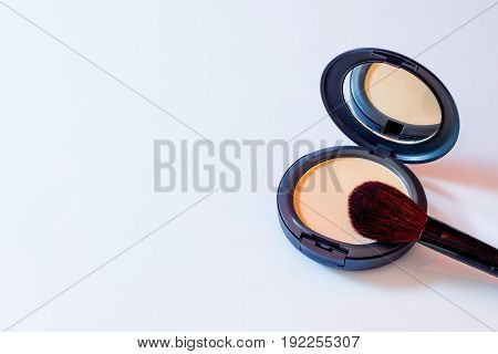 Puff Pastry and Brush cosmetics isolated over white background.