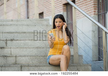 Attractive Latin Woman Shokced Looking At Her Phone
